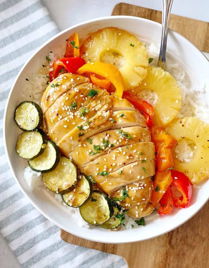 plate of chicken breast with zucchini, pineapple and bell pepper