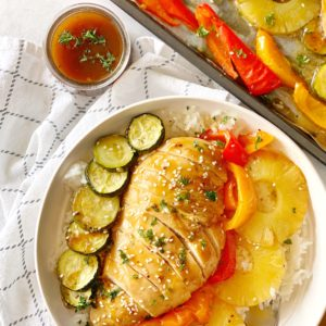close up of baked chicken with vegetables