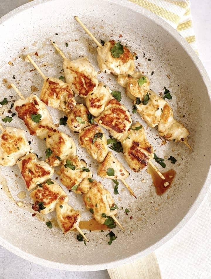 Chicken skewers in a pan