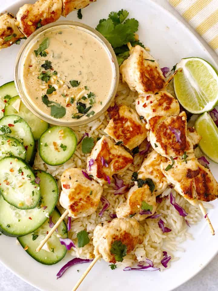Chicken skewers with cucumber and peanut sauce