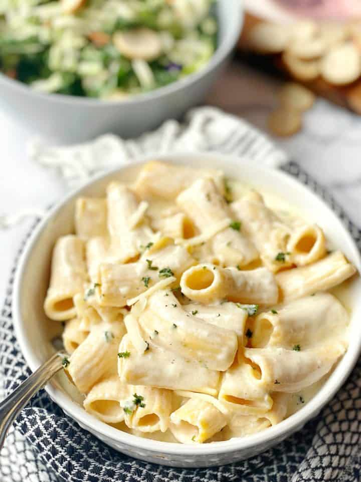 bowl of pasta with alfredo sauce