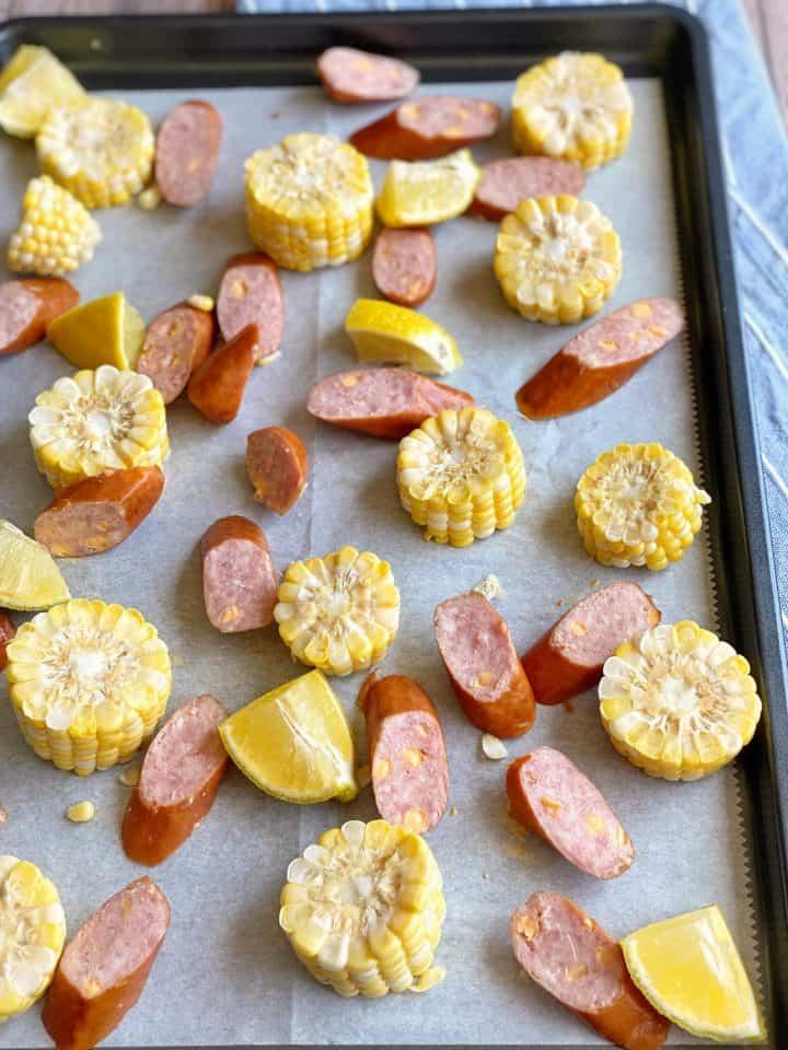 sausage, corn on sheet pan