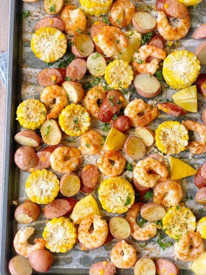 shrimp corn and lemon on sheet pan with potatoes