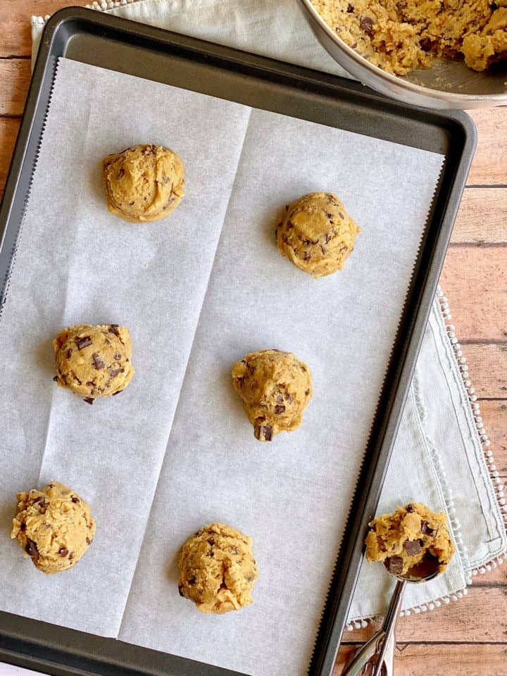 Prepared cookie sheet with cookie dough mounds
