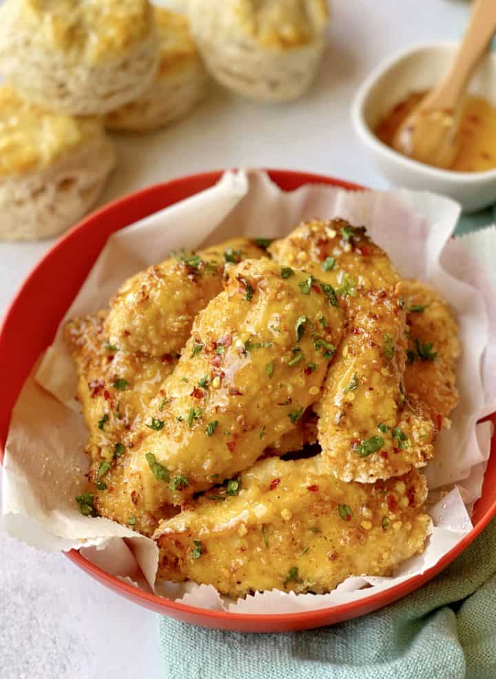 close up of chicken strips in a basket