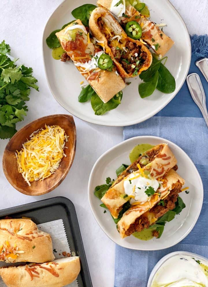 plated taco rolls on plate with side of cheese