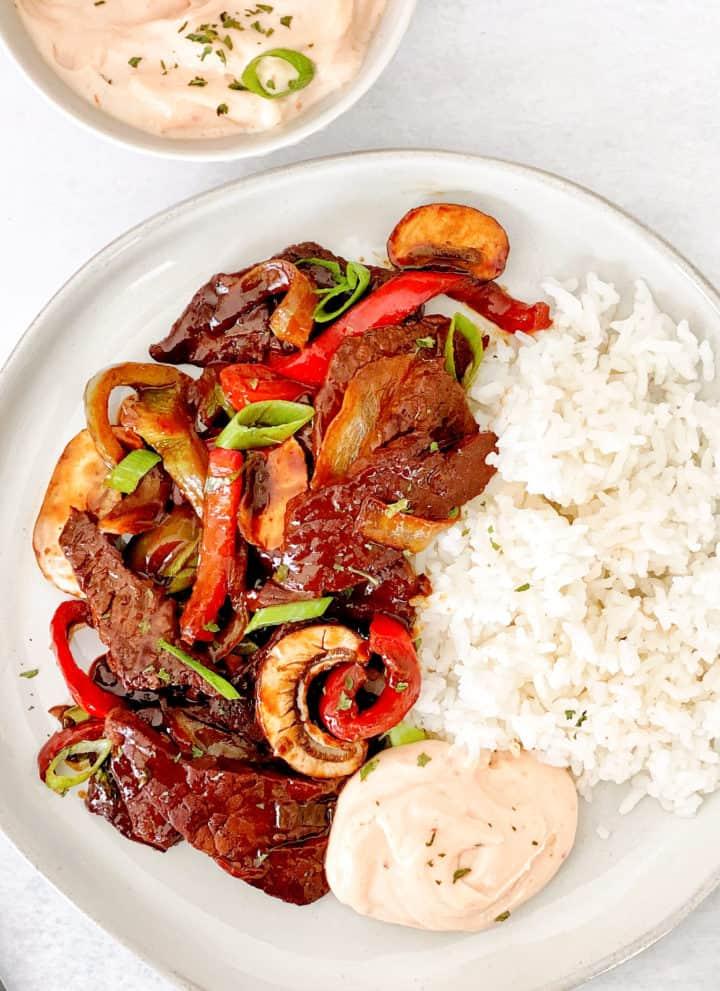 close up of teriyaki beef and yum yum sauce