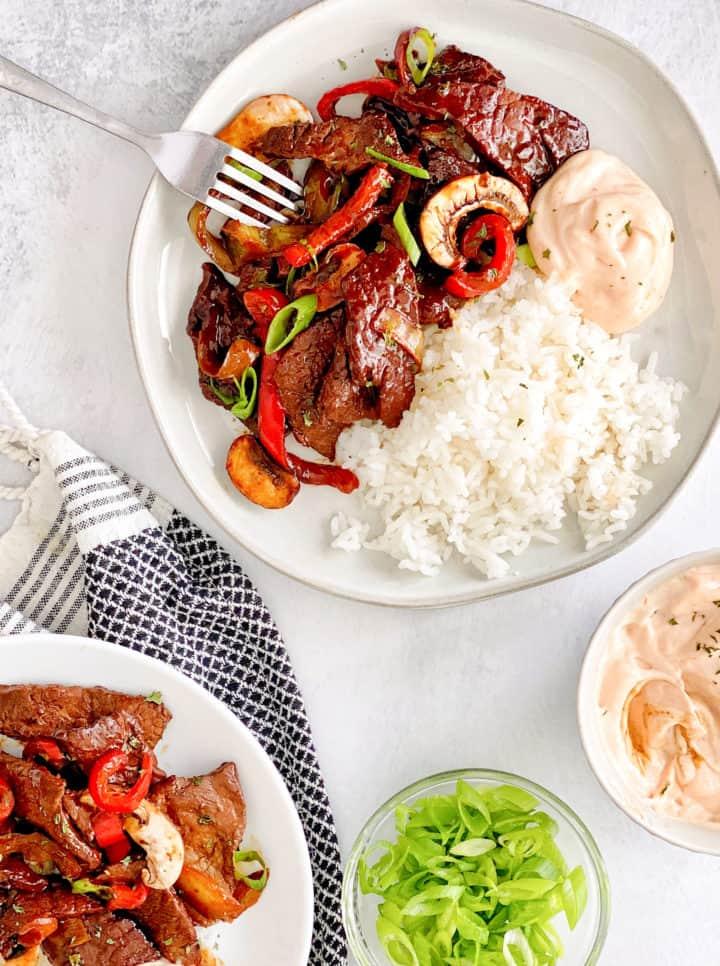 plates of teriyaki beef and yum yum sauce
