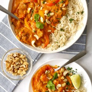 two bowls of chicken curry and rice