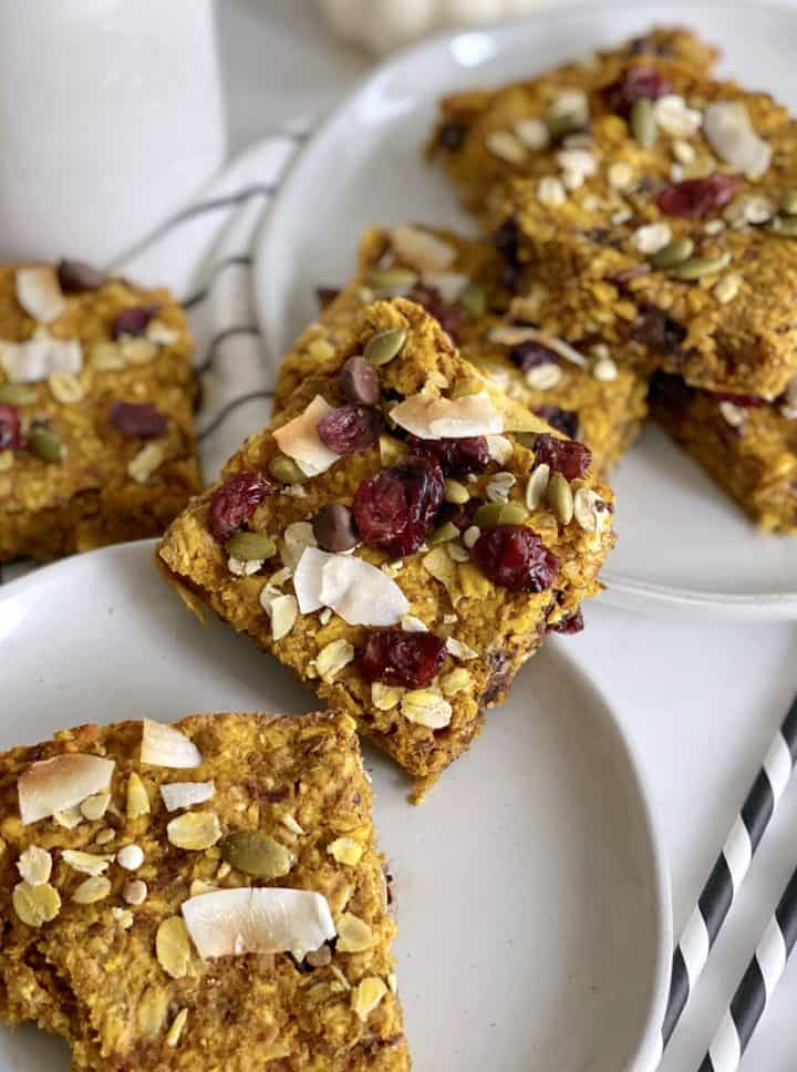 Several pumpkin oatmeal bars scattered on a plate