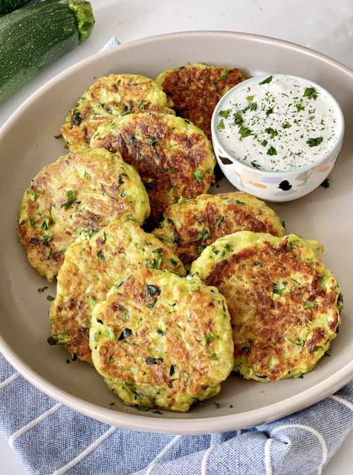 veggie patties on a plate with some ranch dressing