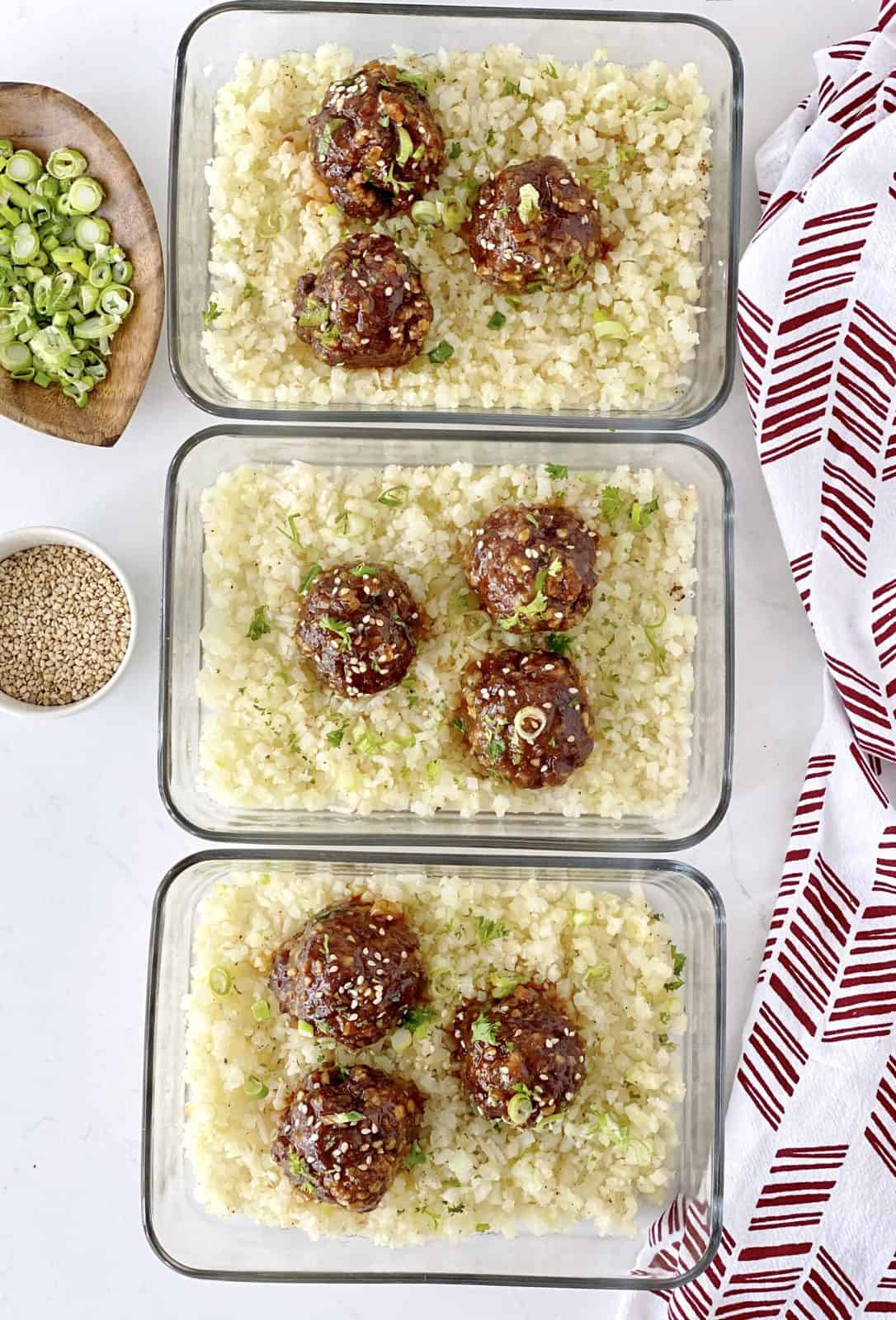meal prep glass containers with meatballs and caulliflower rice