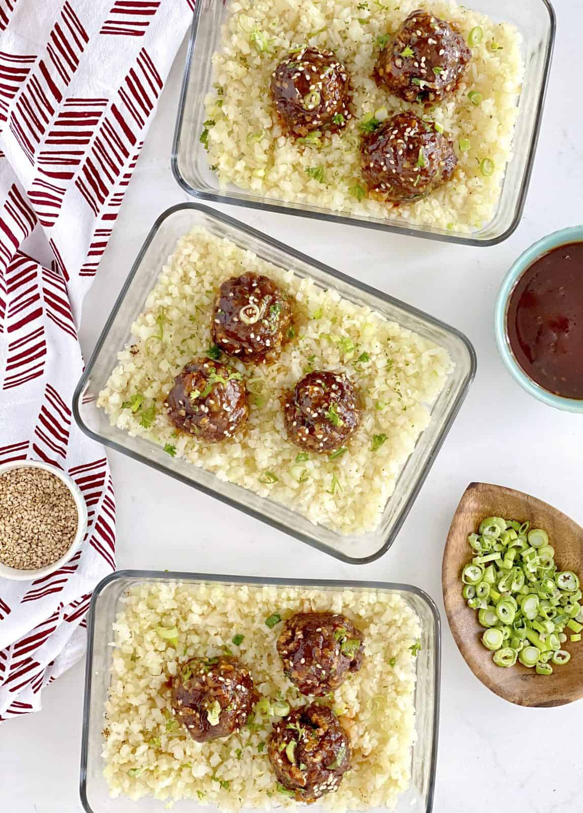 over the top shot of glass containers with meatballs and cauliflower rice