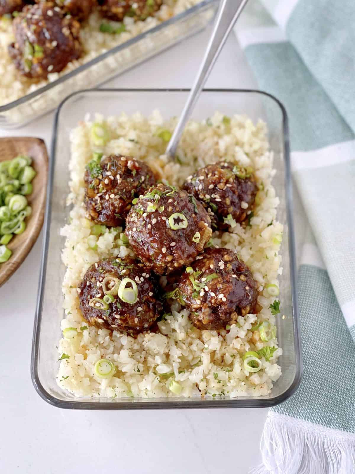 close up of meatballs on cauliflower rice