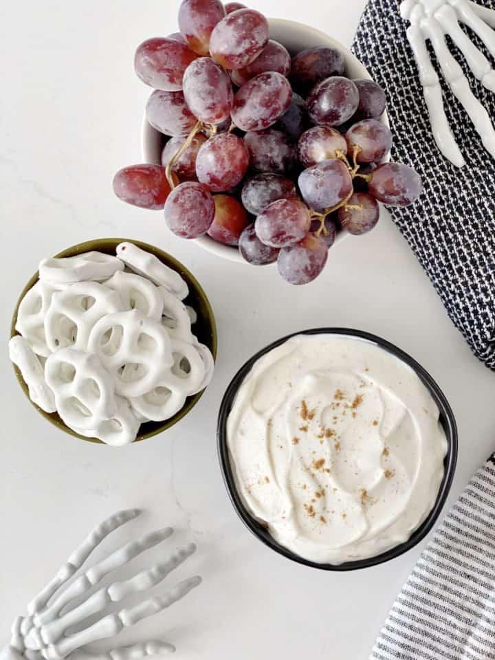 board of grapes, yogurt and pretzels
