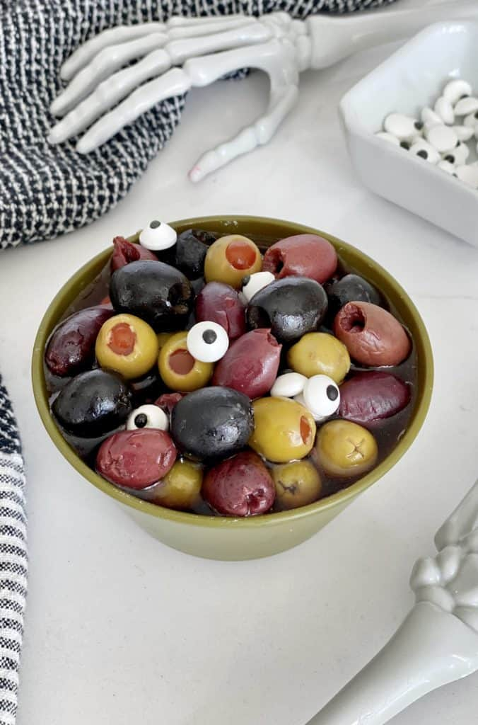 olives in a bowl with napkin on the side