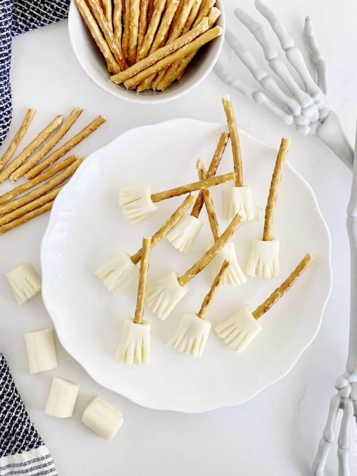 pretzel cheese brooms on a plate next to cheese and pretzels