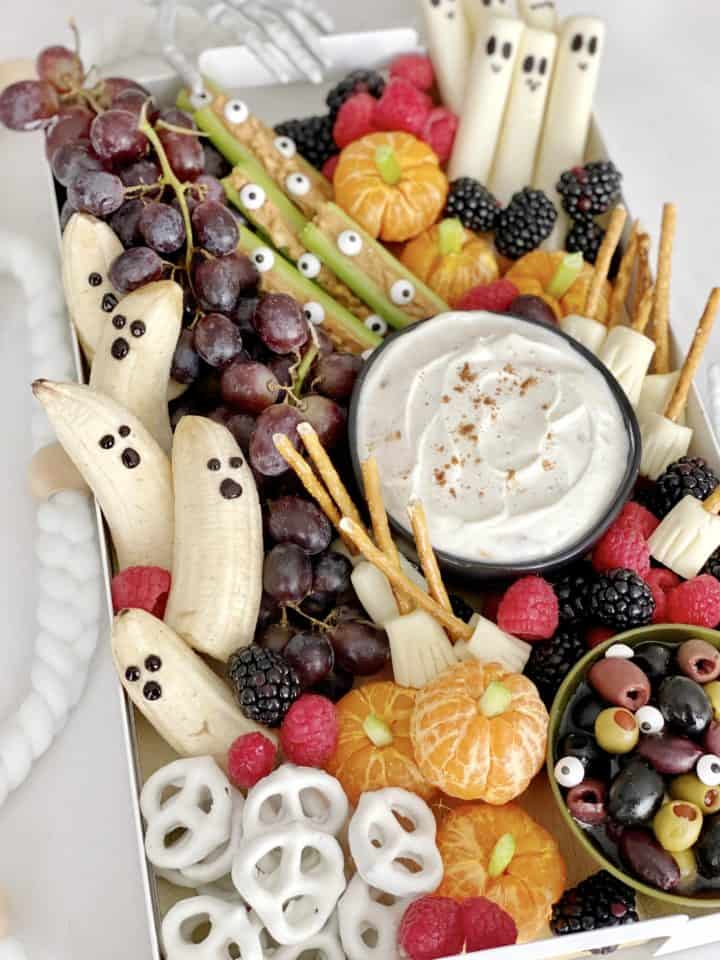 close up of full snack board with halloween snacks