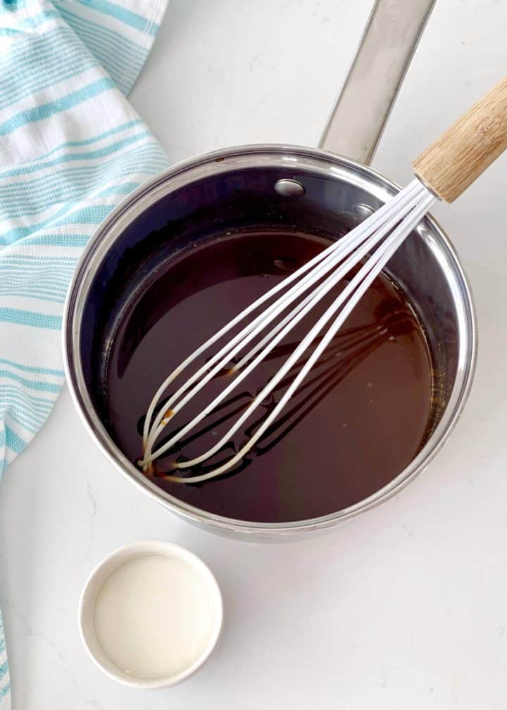 sauce pan wit whisk and mixture