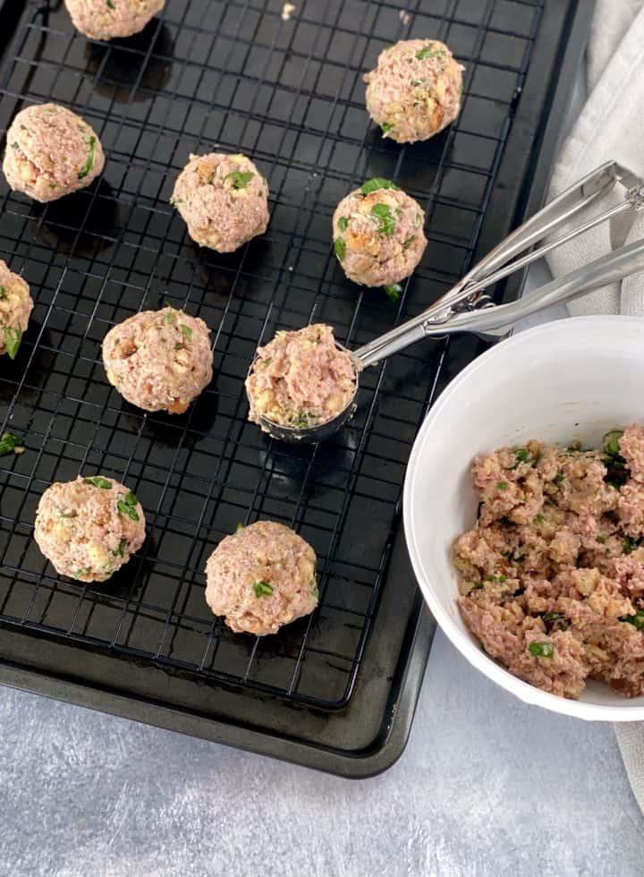 preparing meatballs with cookie scooper