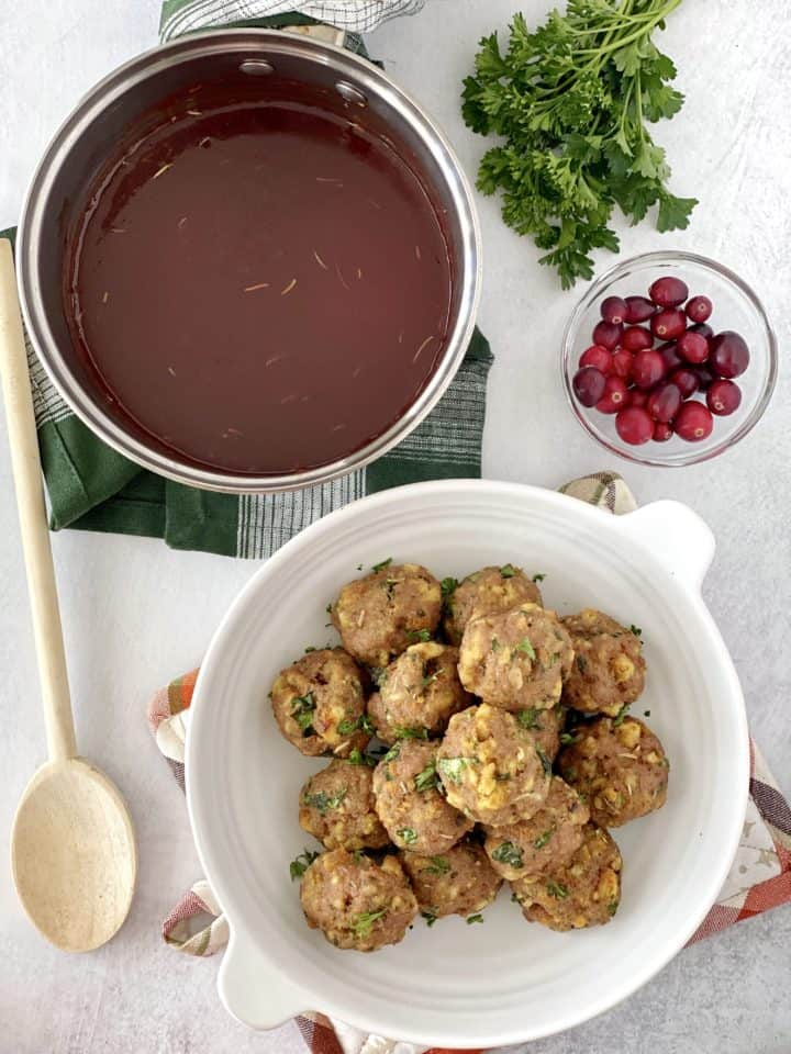 over the top shot of cranberry sauce next to meatballs and cranberry
