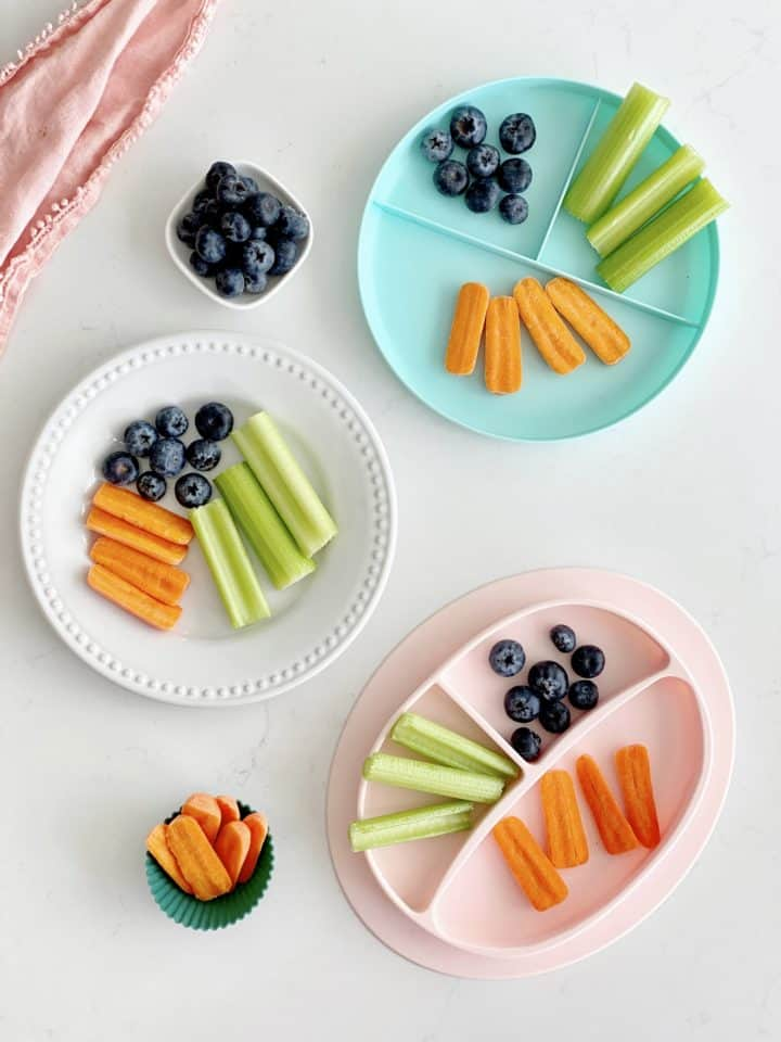 cut up vegetables on several plates