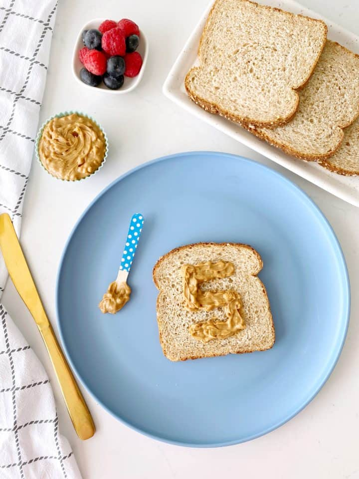 plate with peanut butter and a spoon