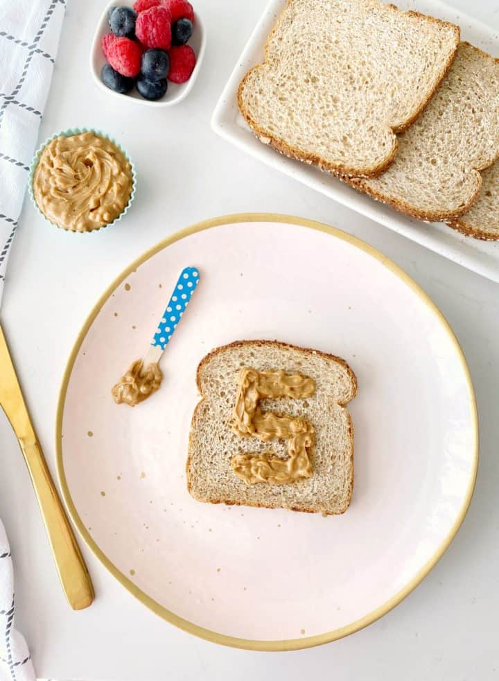 plate with sandwich and peanut butter
