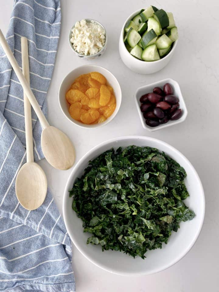 over the top ingredients of kale, oranges, olives