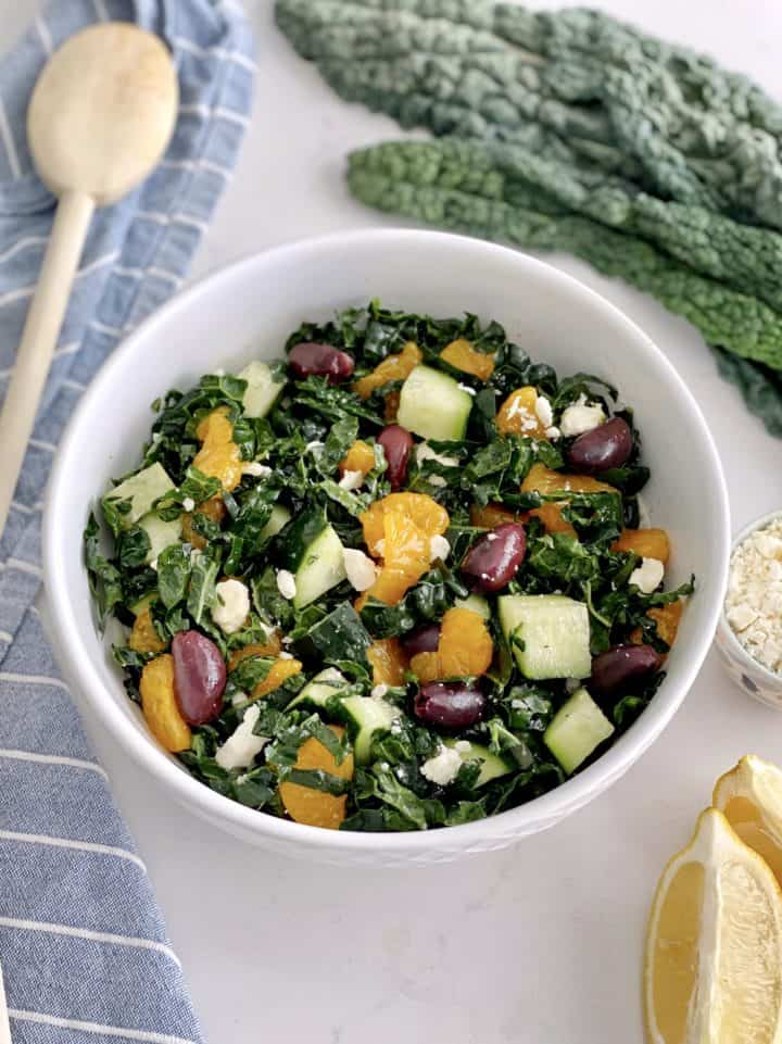 kale salad in a bowl with spoon
