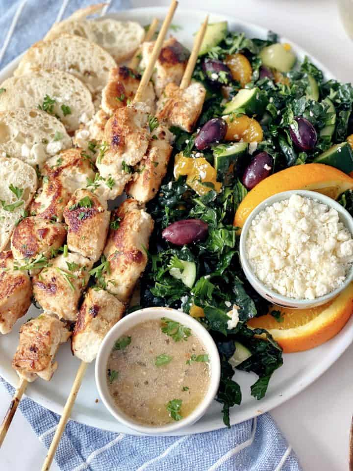 close up of skewers and kale salad