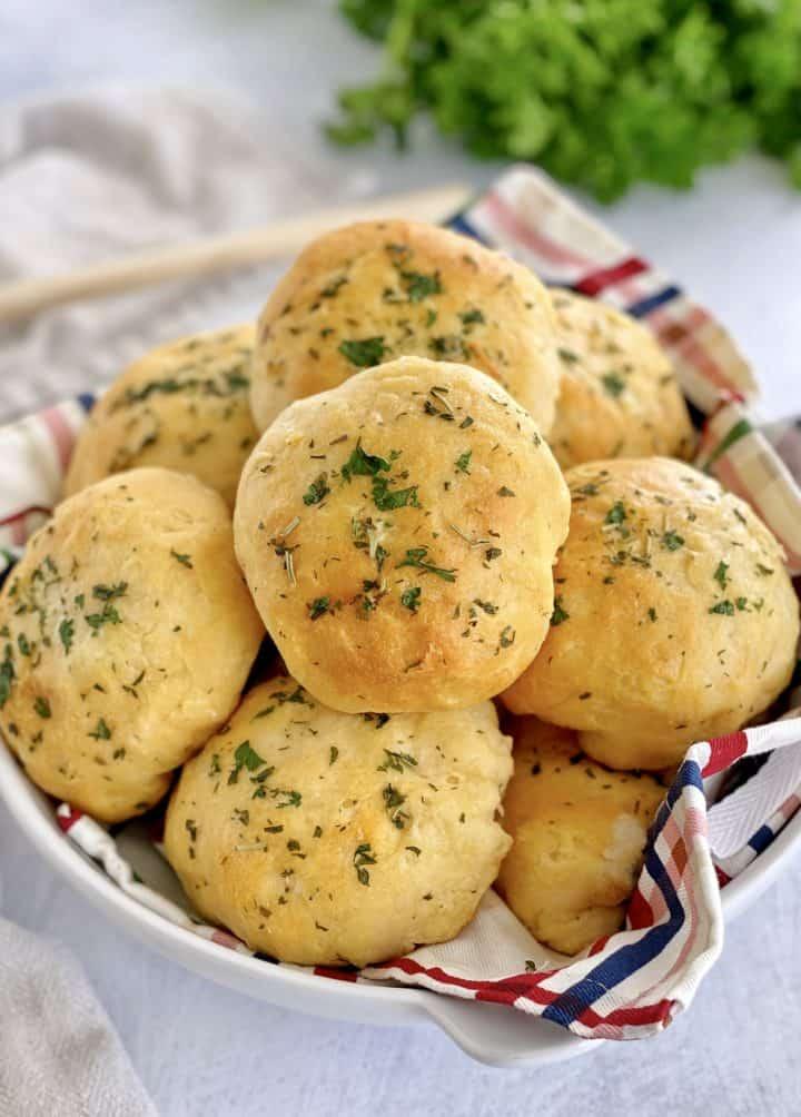 bowl of drinner rolls with garnish