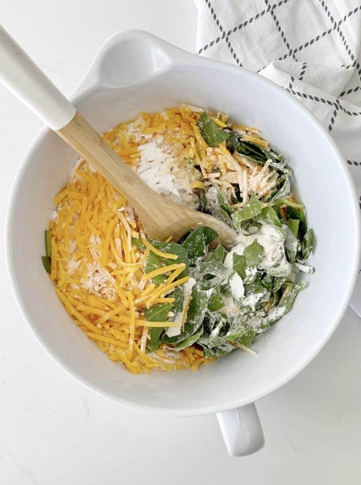 bowl f spinach, cheese, flour