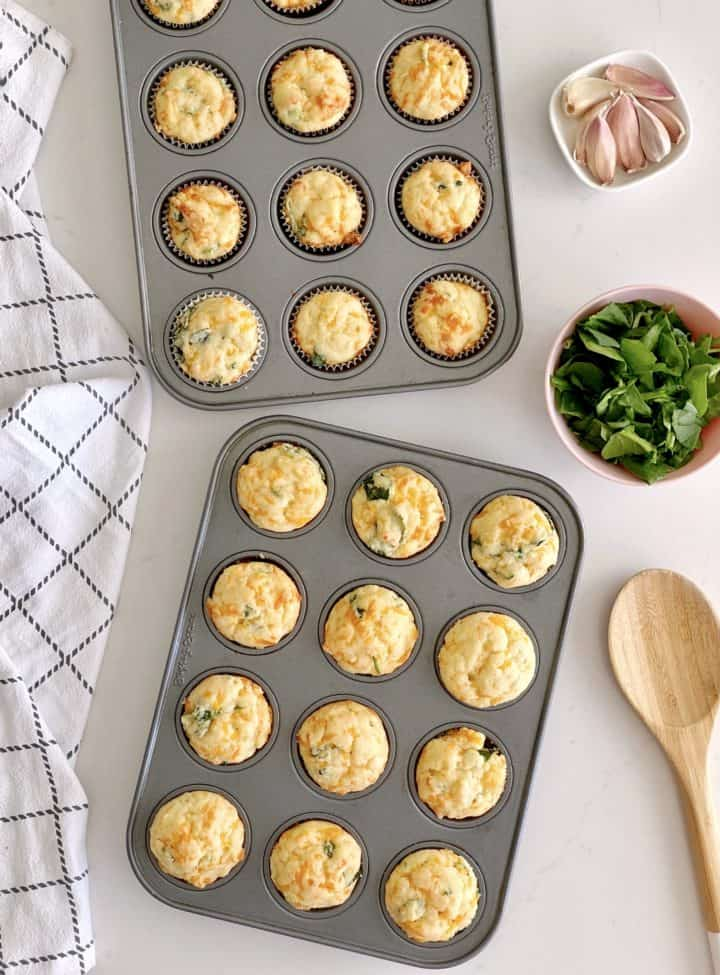 muffin tins filled with spinach cheddar muffins