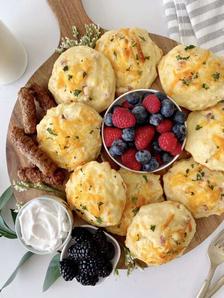 snack board with cheddar biscuits and fruit and sausage