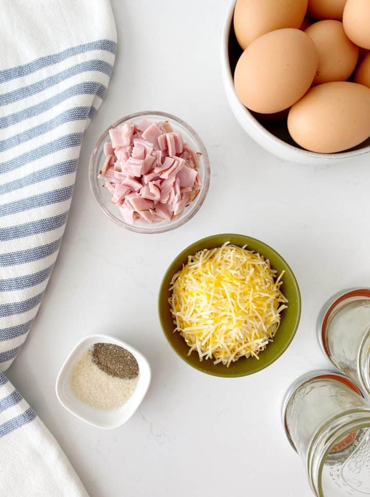egg and ingredients on a counter to make microwave scrambled eggs