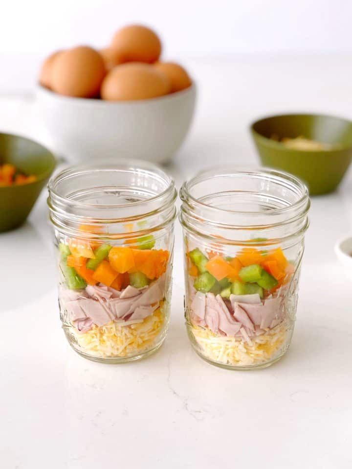 jar filled with bell peppers, cheese and ham