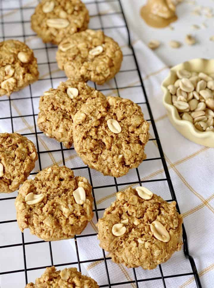 cookies on wire rack with peanuts on side