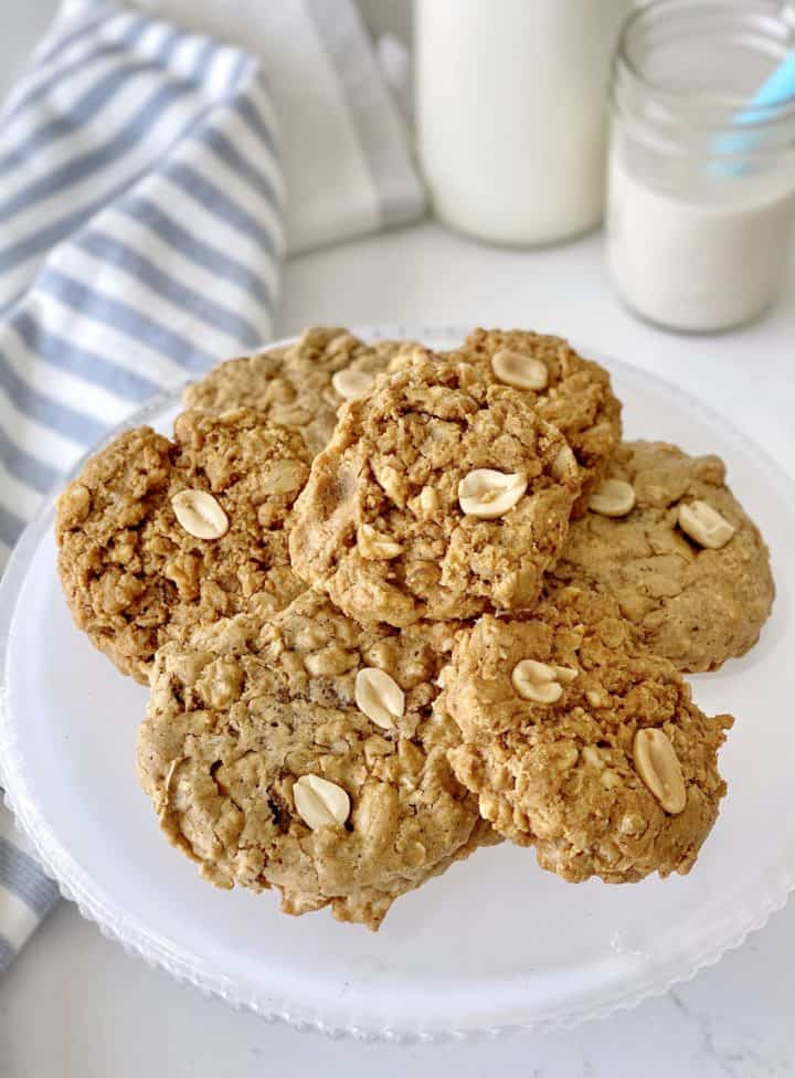 plateful of oatmeal cookies next to some milk