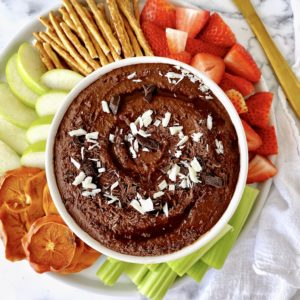 chocolate hummus with pretzels and fruit on a platter