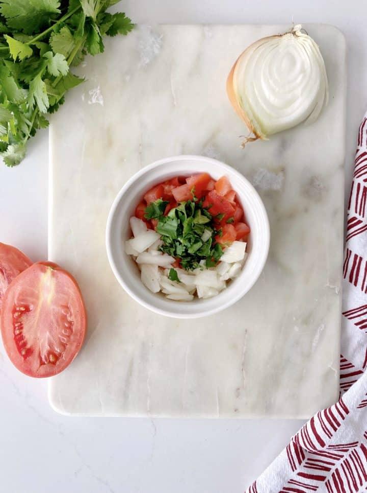onions, tomato and cilantro