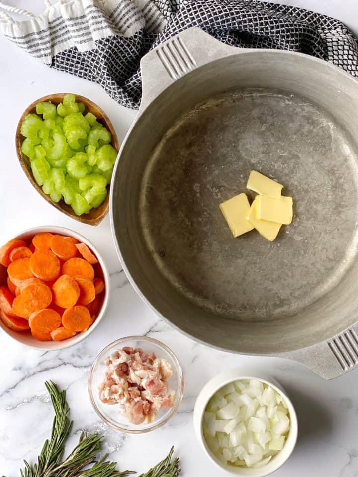 pot next to chopped vegetables
