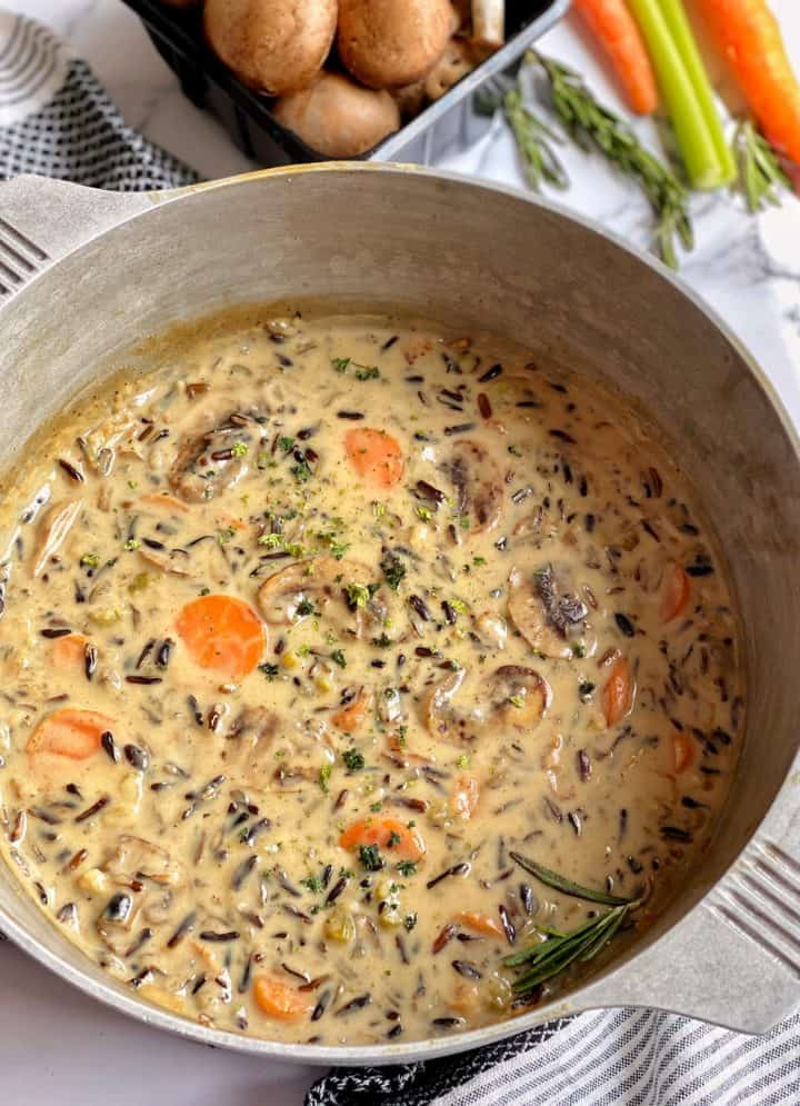pot with wild rice in creamy mushroom soup