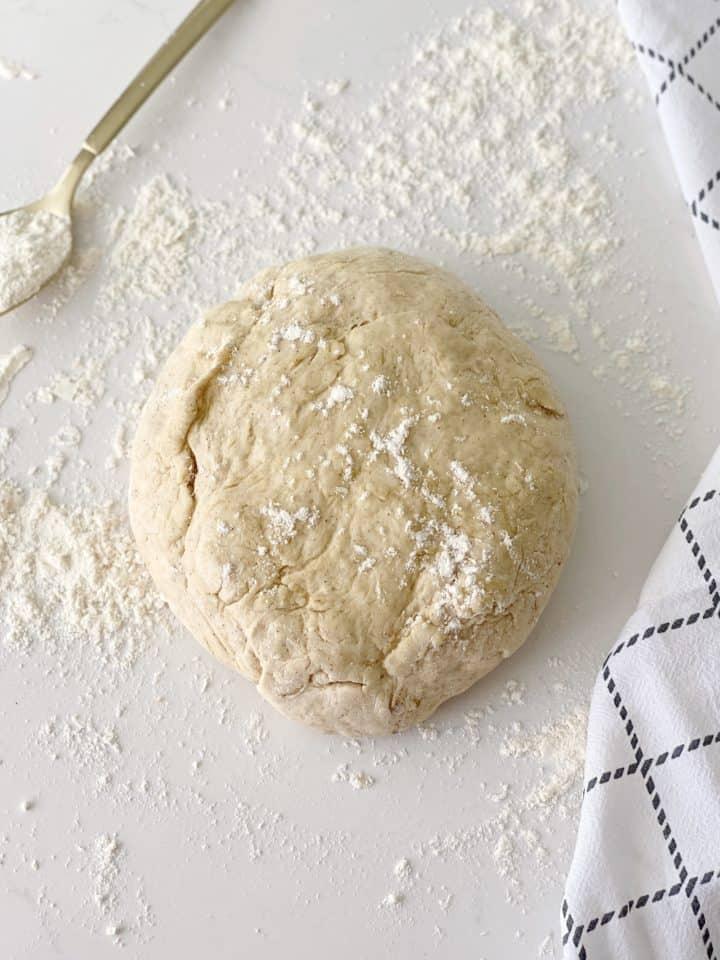dough ball on a floured surface