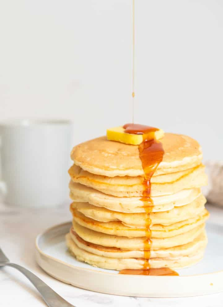 pancakes stacked with syrup on top