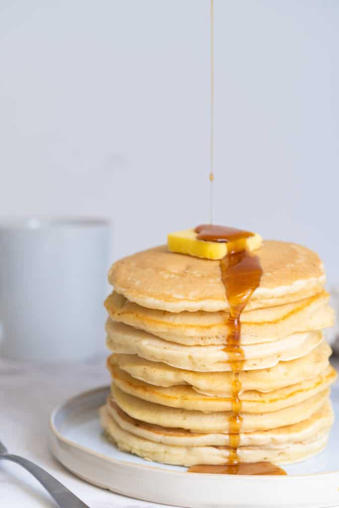 stack of pancakes with maple syrup drip