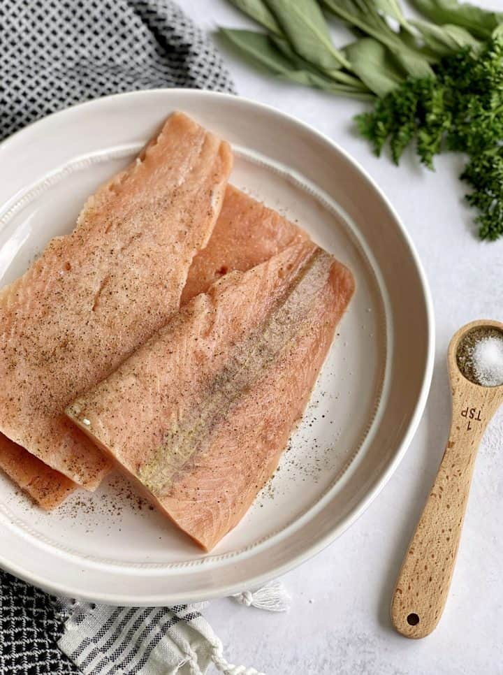 salmon with salt and pepper on the side