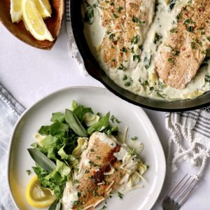 serving portion of salmon with pan of salmon
