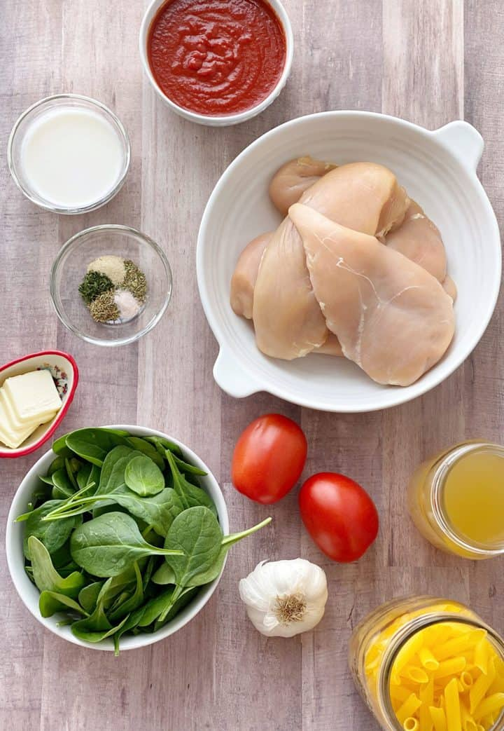over the top shot of ingredients for chicken penne pasta