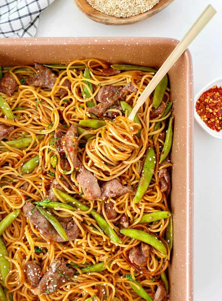 pan with noodles snow peas and beef